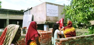 Women collecting drinking water at Deluti MAR system after cyclone Amphan - source - Dhaka University 2020